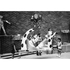 Children with a float and theatrical props.