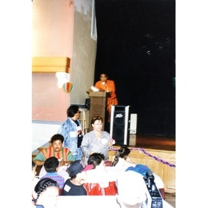 Young man addressing the audience during an event organized by Inquilinos Boricuas en Acción's Teen and Kid Empowerment Program.