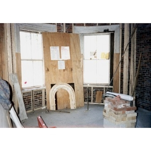 Renovation work in progress on the bay windows of the building at 326 Shawmut Avenue.