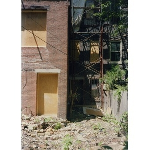 The rubble-strewn backyard of 326 Shawmut Avenue while the building was undergoing renovation.