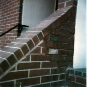 Brick staircase that has been repaired.