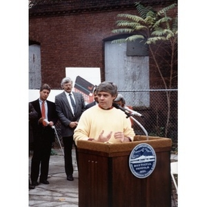 Unidentified man speaking at the podium during the Taino Tower ground breaking ceremony.