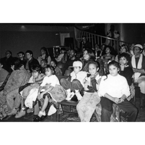 Children and adults in the audience at the Jorge Hernandez Cultural Center.
