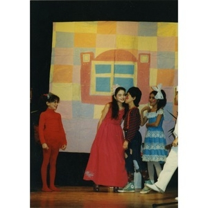 Children in an Areyto program performing in a play on stage at the Jorge Hernandez Cultural Center.
