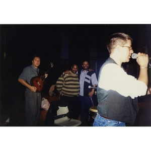 Alex Alvear (right, with the microphone), Claudio Ragazzi (left), and two unidentified Areyto musicians.