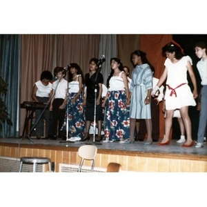 Young singers on stage.