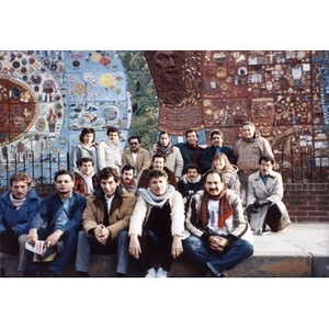 Group portrait in front of the ceramic tile mural.