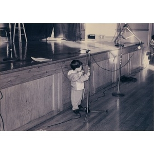 Small boy playing with the microphone at the Jorge Hernandez Cultural Center.