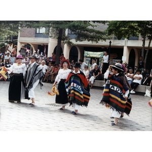 Dancers in folk costume in the plaza at Festival Betances.