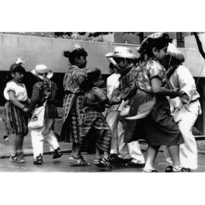 Children in traditional costumes performing a folk dance at Festival Betances.