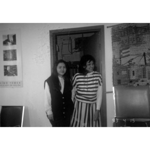 Two women standing in front of an open door in the Inquilinos Boricuas en Acción offices.