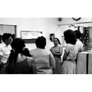 Unidentified woman addresses people who have gathered to learn more about Villa Victoria and Inquilinos Boricuas en Acción.