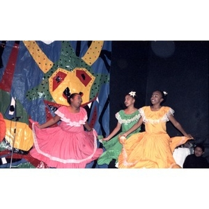 Girls performing a folk dance on stage.