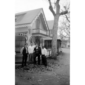 Alex Alvear and Claudio Ragazzi with two unidentified men pose in front of a house.