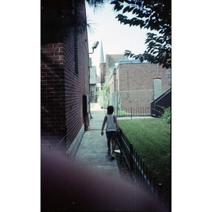 Child walking down the alley that runs alongside the ruins of the former Shawmut Congregational Church.
