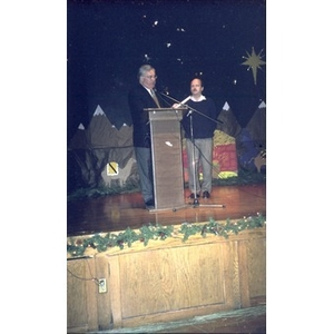 David Cortiella and Mayor Thomas Menino on stage during celebration of Three Kings Day.