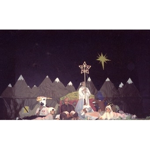 Children perform a Christmas pageant on Three Kings Day.