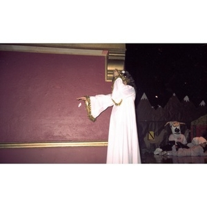 Girl dressed as an angel walks on the stage during a Christmas pageant performance on Three Kings Day.