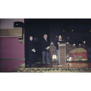 David Cortiella, Mayor Menino, and an unidentified man on stage during a Three Kings Day celebration at the Jorge Hernandez Cultural Center.