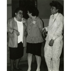 Three women sharing a moment of laughter.