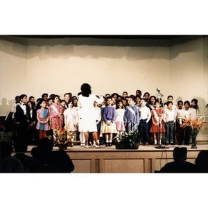 Choir of schoolchildren performing at the ceremony celebrating the opening of the Villa Victoria Cultural Center.