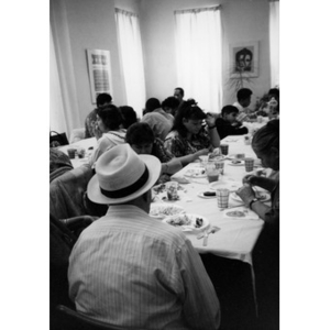 Community members sharing a meal at Inquilinos Boricuas en Acción headquarters.