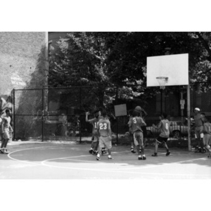 Kids playing basketball in a playground in the Villa Victoria neighborhood.