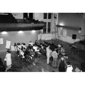Bird's-eye view of a community meeting at the Jorge Hernandez Cultural Center.