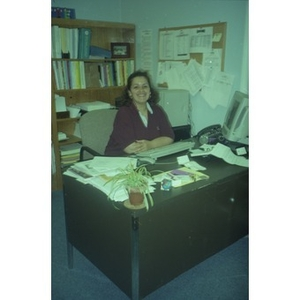 Woman at her desk in her office.