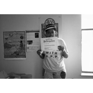 Young woman displaying her Certificate of Participation.
