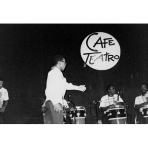 Los Muñequitos de Matanzas, a percussion, vocal, and dance ensemble from Cuba, on stage for a Café Teatro performance.