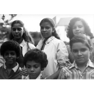 Group portrait of the children of Areyto's singing group, the Cantantes de Areyto.
