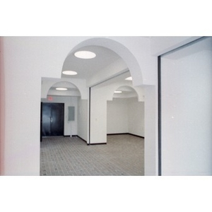 Archways in a newly constructed suite of commercial or office spaces.