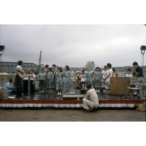 Young singers from Villa Victoria performing outside behind the New England Aquarium.