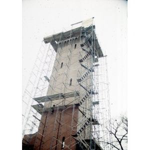 The tower of the former Shawmut Congregational Church wrapped in scaffolding during the construction of Taino Tower.