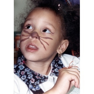 Little girl with an animal nose and whiskers painted on her face.