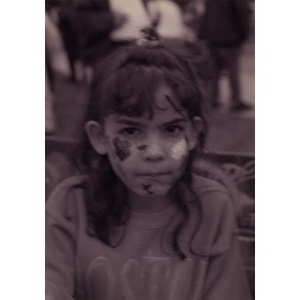 Little girl with her face painted.