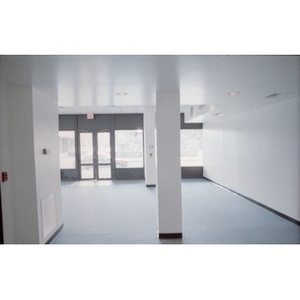 Clean white walls of newly built ground floor commercial space.
