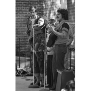Musical group, consisting of two men and two women, performs at a Latino street festival.
