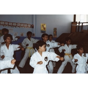 Class of young Latino boys performing a karate demonstration at the Festival Betances, Boston, 1986.