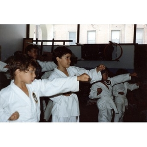 Classroom of young Latino boys performing a karate demonstration at the Festival Betances, Boston, 1986.