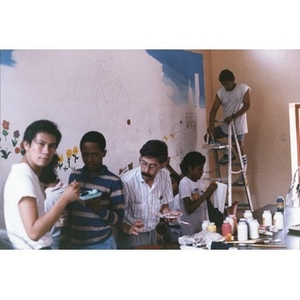 """Tito Fuster helps Latino teenagers to paint the mural """"Say no to Drugs, Say yes to Your Community,"""" La Alianza Hispana Community Center, Roxbury, Mass."""