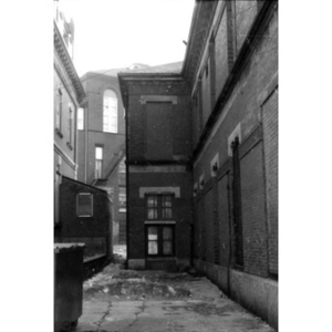 Alleyway between 409 Dudley Street (building on left) and 407 Dudley Street (right), La Alianza Hispana headquarters.