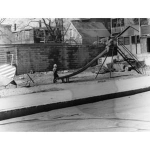 Two African American children on a playground on Howard Avenue, Roxbury, Mass.