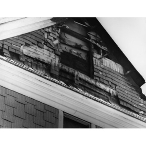 Exterior view of dilapidated attic window of house at 12 Intervale Street, Roxbury, Mass.