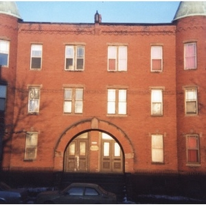 Exterior view of a brick apartment building in Roxbury, Mass.