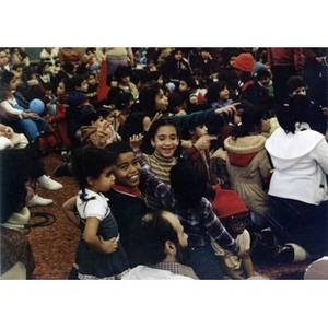 Audience, consisting mostly of Hispanic American children and a few adults, watches the Three Kings' Day celebration at La Alianza Hispana, Roxbury, Mass., in 1982.