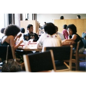 Hispanic people seated and eating in a dining area at a La Alianza retreat, [Aug.?] 1978.