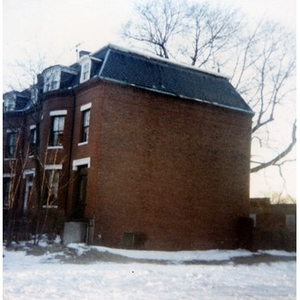 Exterior view of a three-story brick residential building in Roxbury, Mass.