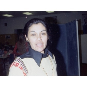 Female staff member at a Christmas party at La Alianza Hispana offices in Roxbury, Mass.